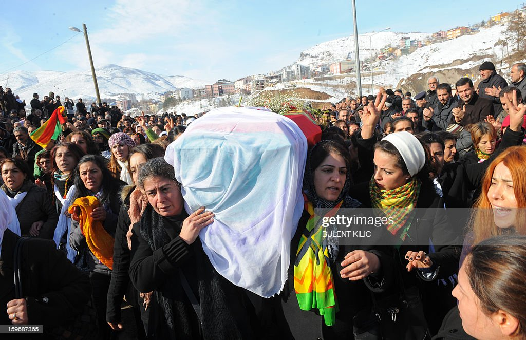Thousnands of people follow the coffin of late Kurdish activist Sakine Cansiz, shot dead in the French capital, during the funeral on January 18, 2013 in Tunceli, her hometown in the Kurdish majority southeast of Turkey. People gathered inTunceli, to pay a final tribute to Sakine Cansiz who was assassinated in Paris last week. The growing crowd of participants, men and women adorned in white scarves, a symbol of peace, marched in a funeral many in Turkey feared would turn into a violent protest. The three women, one of them Sakine Cansiz, a co-founder of the outlawed Kurdistan Workers' Party (PKK), were found fatally shot, at least three times in their heads, at a Kurdish centre in Paris last week. French police were hunting the unknown assailants. AFP PHOTO/BULENT KILIC