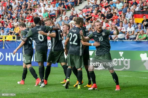thr players of Germany celebrates after scoring the second goal during the UEFA European Under21 Championship Semi Final match between England and...