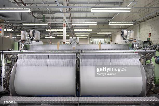 Thread on industrial loom in textile mill