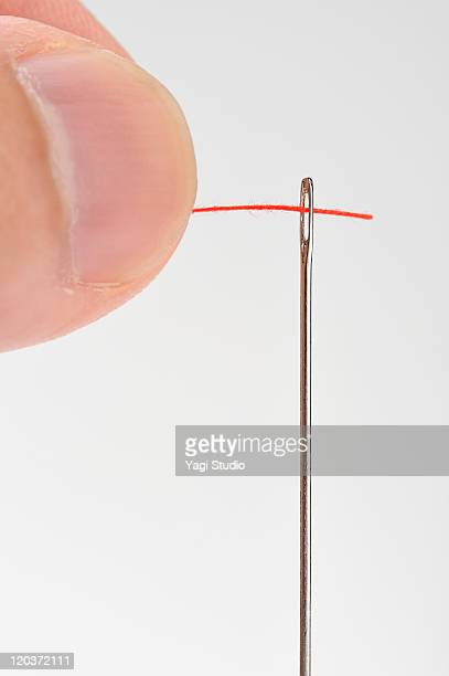 Threading needle, close up