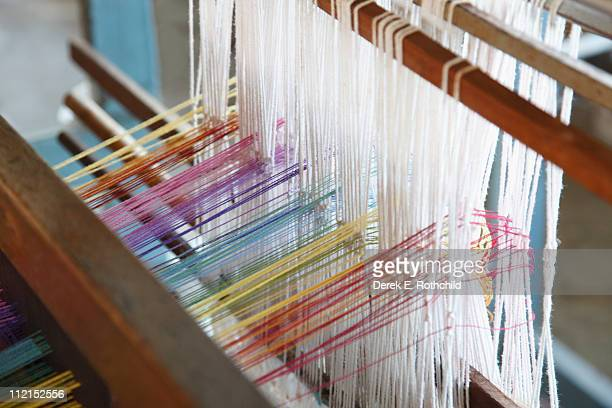 Threads being woven on hand loom