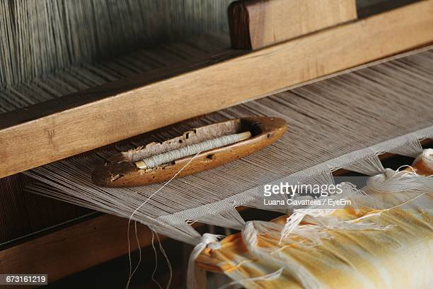 Threads On Loom At Factory