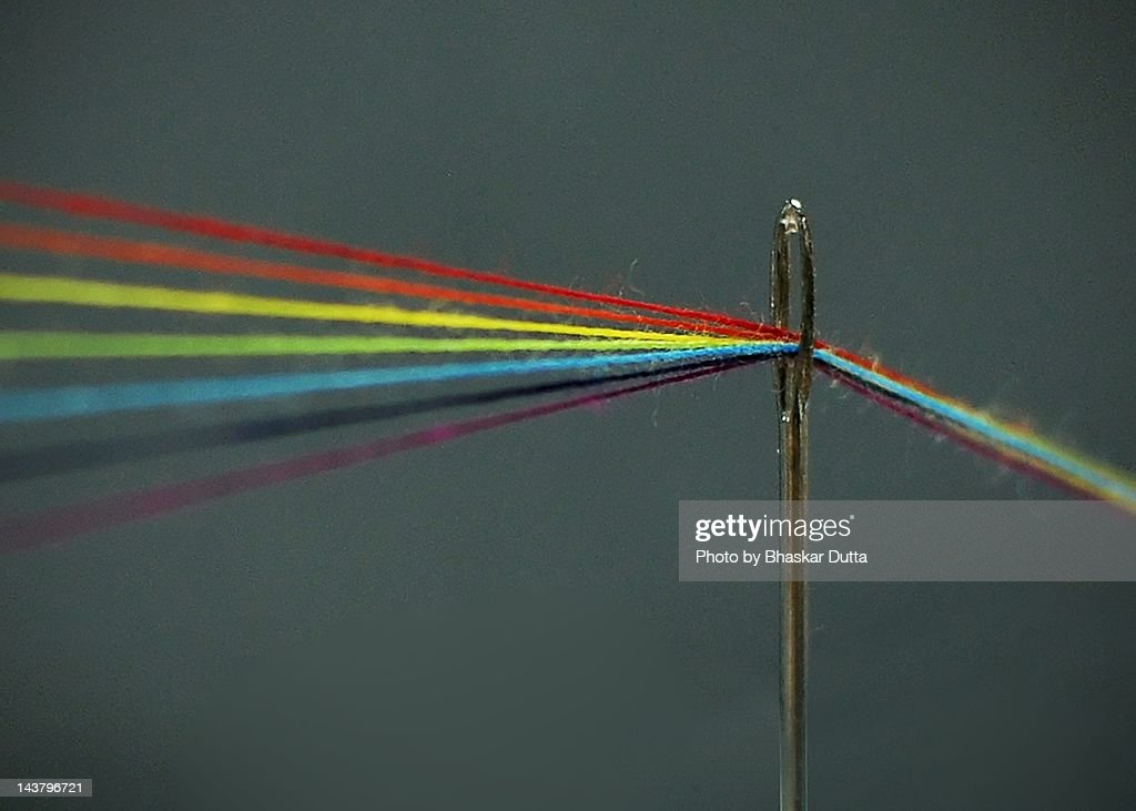 Threads through needle