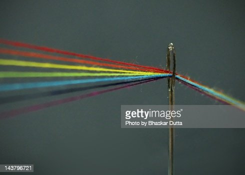 Threads through needle : Foto stock