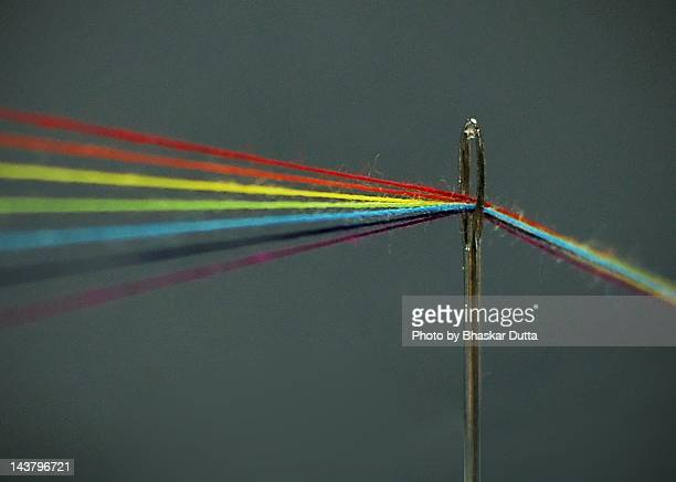 Threads through needle