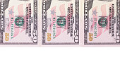 Three 50 dollar banknotes isolated on white background