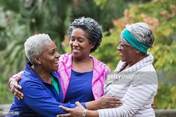 Three African American senior women talking
