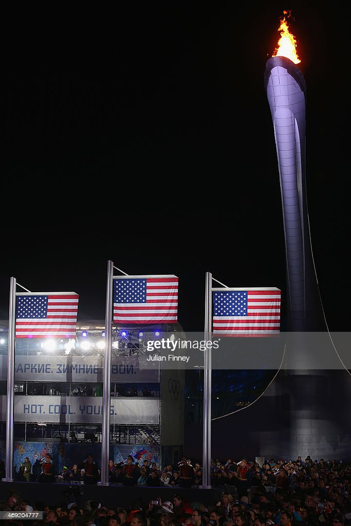 Three American flags are raised for the silver medalist Gus Kenworthy of the United States gold medalist Joss Christensen of the United States and...