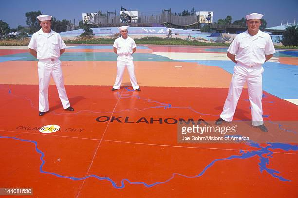 Three American Sailors Standing on Map of the United StatesSea World San Diego California