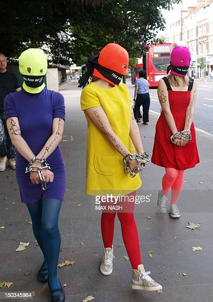 Three Amnesty International activists dressed as the Russian Band Pussy Rioters outside the Russian Embassy in London on August 12 2012 protest for...