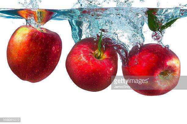 Three Apples Splash Into Water