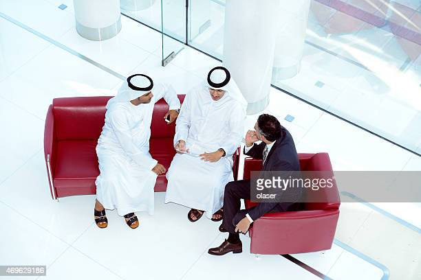 Three arab business men meeting