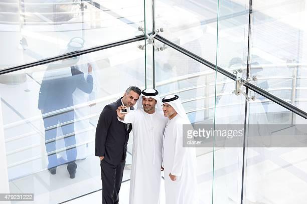 Three arab business men taking a selfie