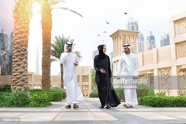 Three arab business people outside