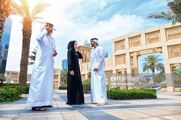 Three arab business people outside