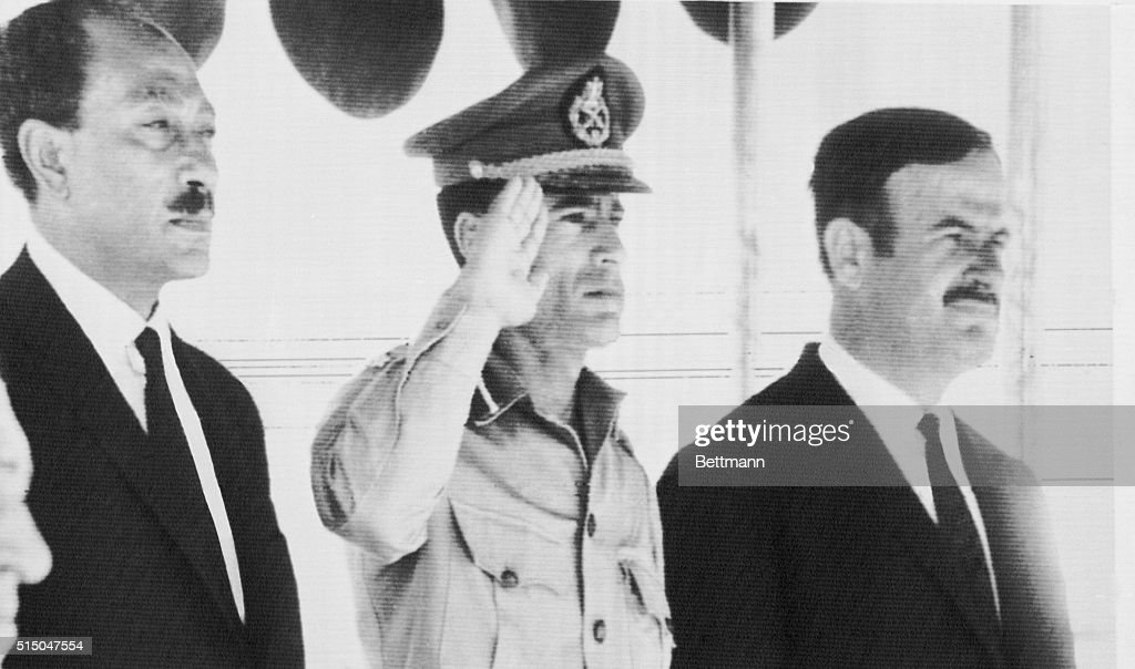 President Anwar Sadat of the UAR, Premier Lt. Col. Muammar al-Qaddafi of Libya and President Lt. Gen. <a gi-track='captionPersonalityLinkClicked' href=/galleries/search?phrase=Hafez+al-Assad&family=editorial&specificpeople=210713 ng-click='$event.stopPropagation()'>Hafez al-Assad</a> of Syria (L-R) are shown here, Aug. 18th, before attending meeting to finalize plans for an Arab federation and to consider the disunity among Arab states. The meeting is the first of its kind here in ten years.