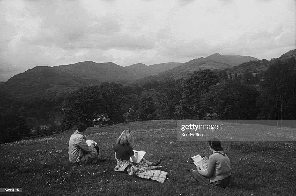 Three art students painting and drawing in the countryside around Ambleside Lake Windermere Cumbria 3rd July 1943 Original publication Picture Post...
