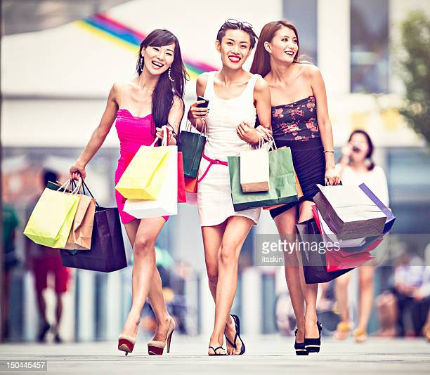 Three asian girls shopping
