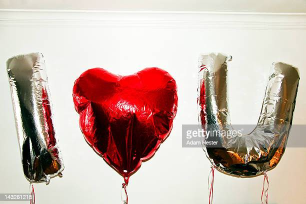 Three balloons with I HEart U spelled out.