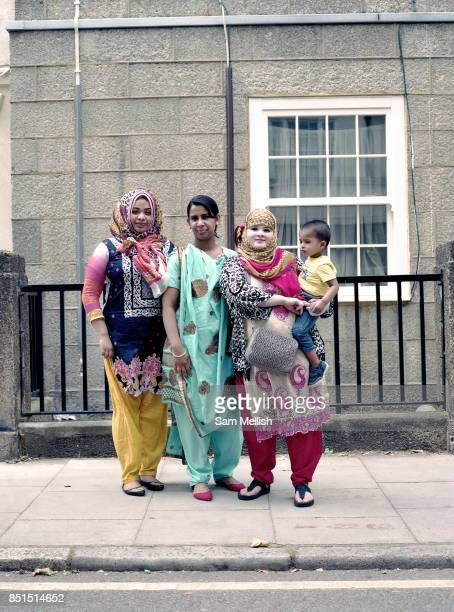 Three Bangladeshi women in traditional sarees with young boy during the Somers Town Festival on 09th July 2016 in London United Kingdom Somers Town a...