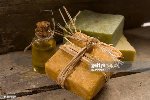 Three bars of natural soap and a jar of oil