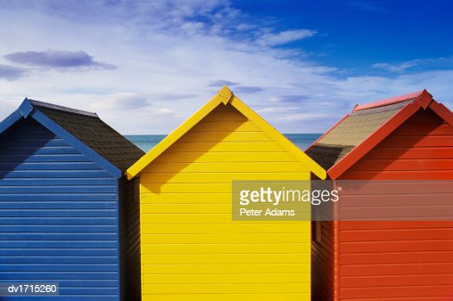 Three Beach Huts in a Row, Painted in Primary Colours, Whitby, North Yorkshire, England : Stock Photo
