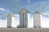 Three beach huts on an empty beach