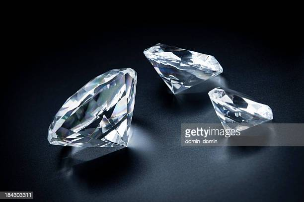 Three beautiful diamonds on a black background.