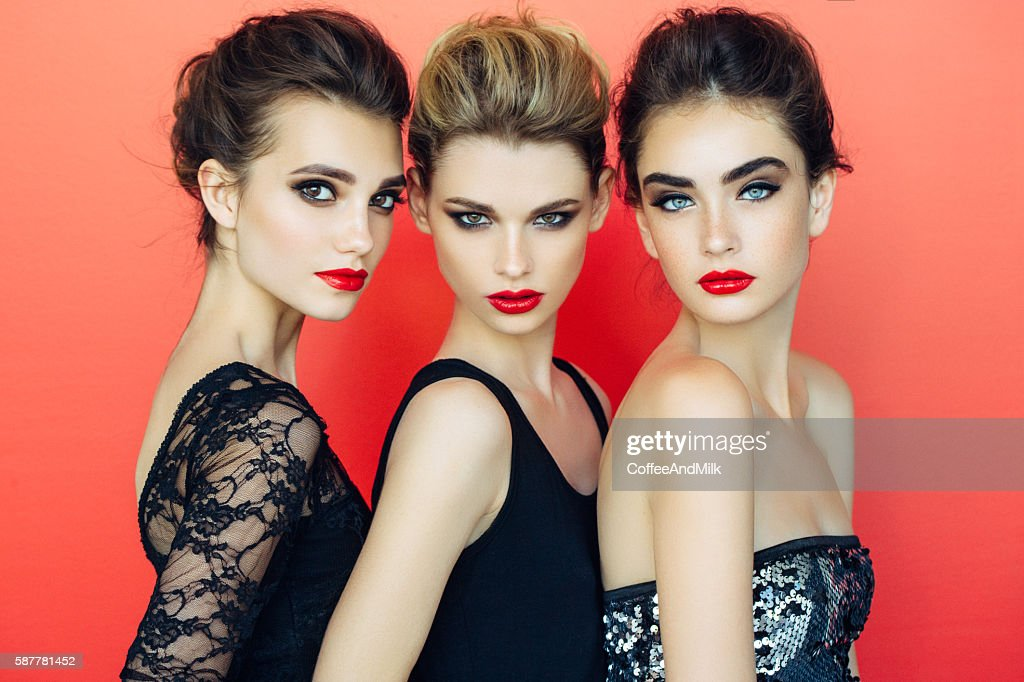 Three beautiful girls with make-up : Stock Photo