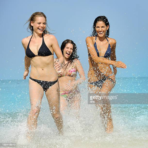 Three Beautiful women splashing through the Waves (XXL)