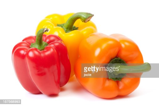 Three bell peppers, a red, a yellow and an orange one
