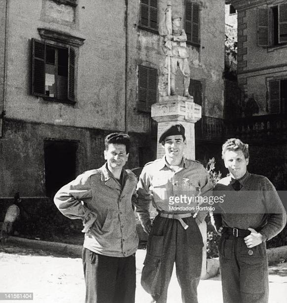 Three Black Feathers partisans pose in a little square of the Piedmontese town Alba October 1944