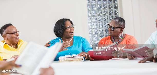 Three black women in bible study group