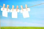 Three cutout blank tshirts made by me on a clothesline