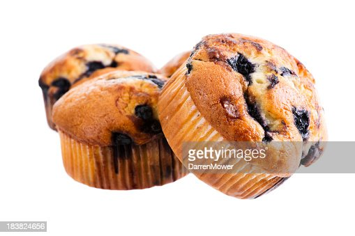 Three blueberry muffins on white background