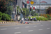 Three bodies lie on the street next to a damaged police post after a series of blasts hit the Indonesia capital Jakarta on January 14 2016 A series...
