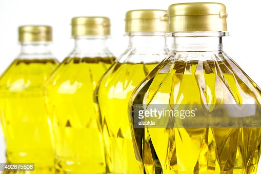 three bottles oil of refined palm olein from pericarp : Stock Photo