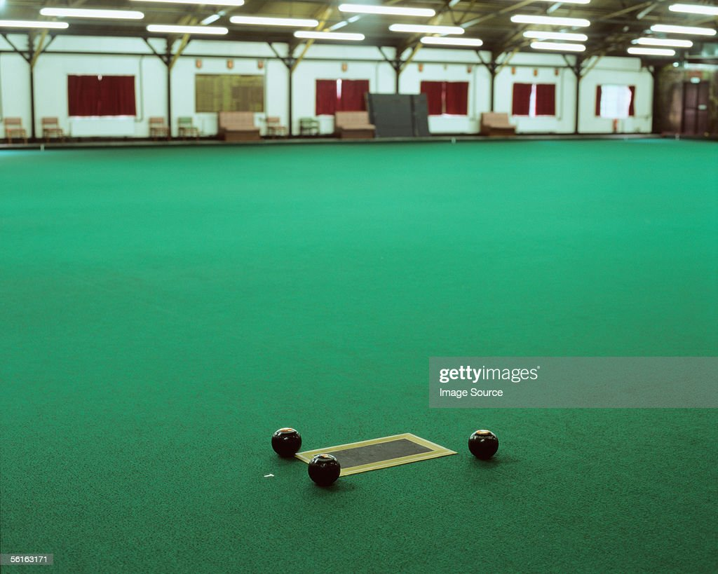 Three bowling balls on a bowling green