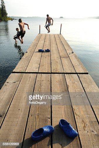 Three boys jumping into Lake Superior, Isle Royal National Park