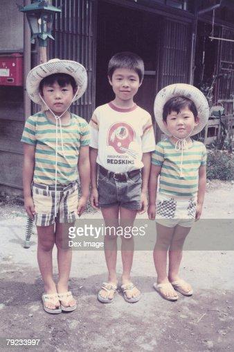 Three brothers at front yard : Stock Photo