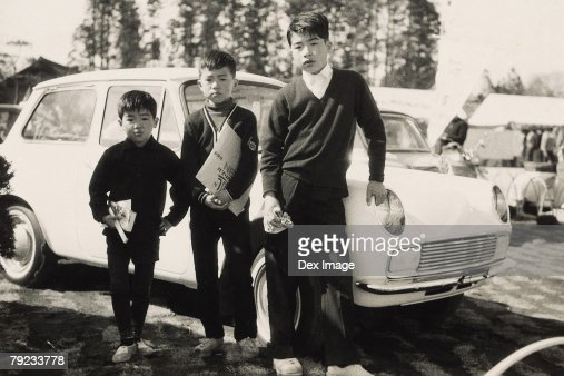 Three brothers in school uniform : Stock Photo