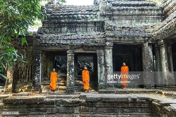 Three buddhist monks at Angkor wat