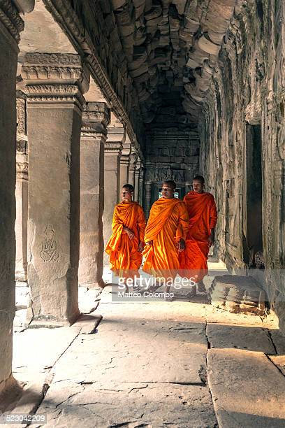 Three buddhist monks inside temple, Angkor Wat