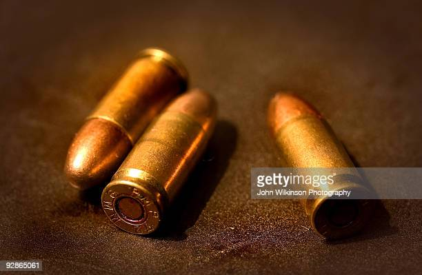 Three bullets on textured background