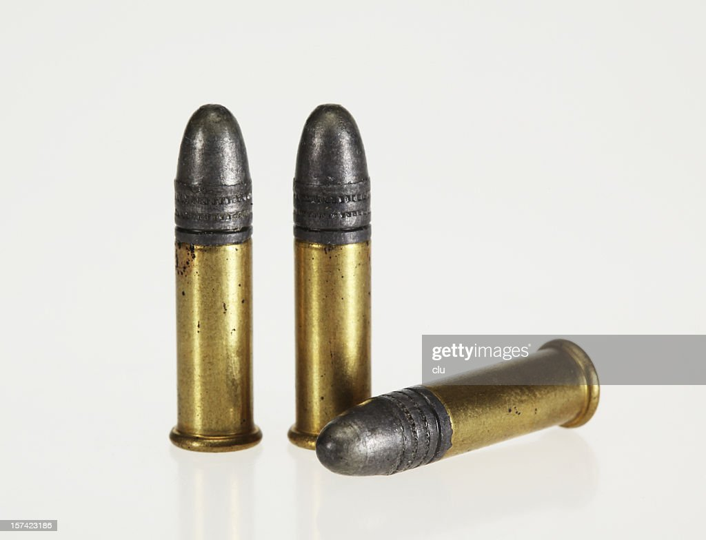 Three bullets on white background