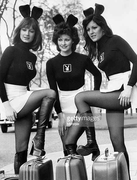 Three Bunny girls with suitcases March 1975 P018478
