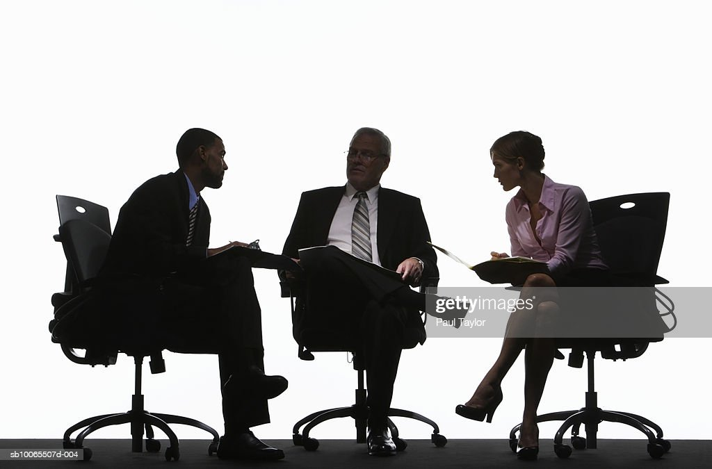 Three business executives having meeting