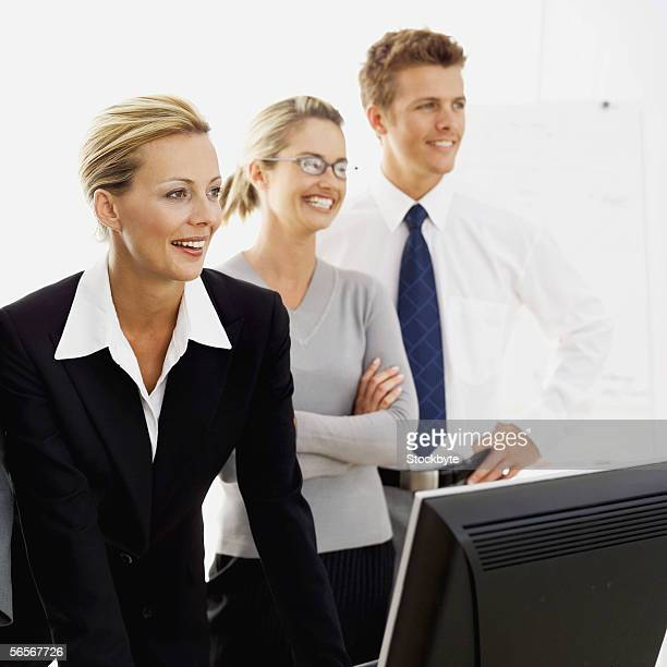 three business executives smiling in an office