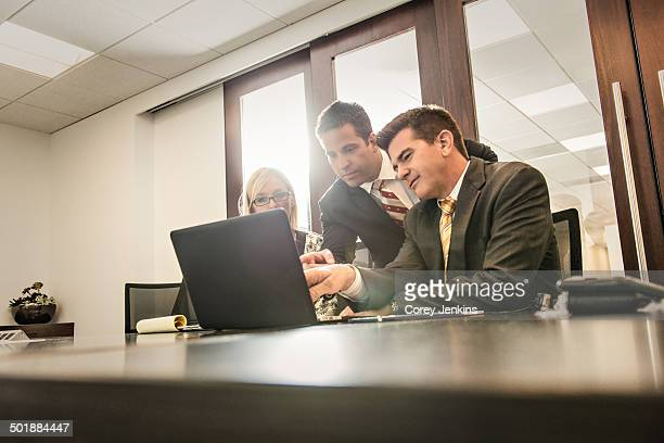 Three business lawyers having a planning meeting in office