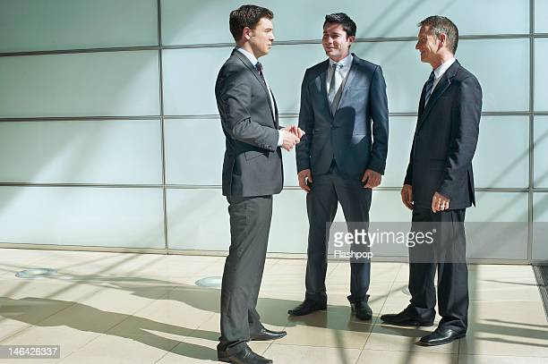 Three business men having an informal meeting
